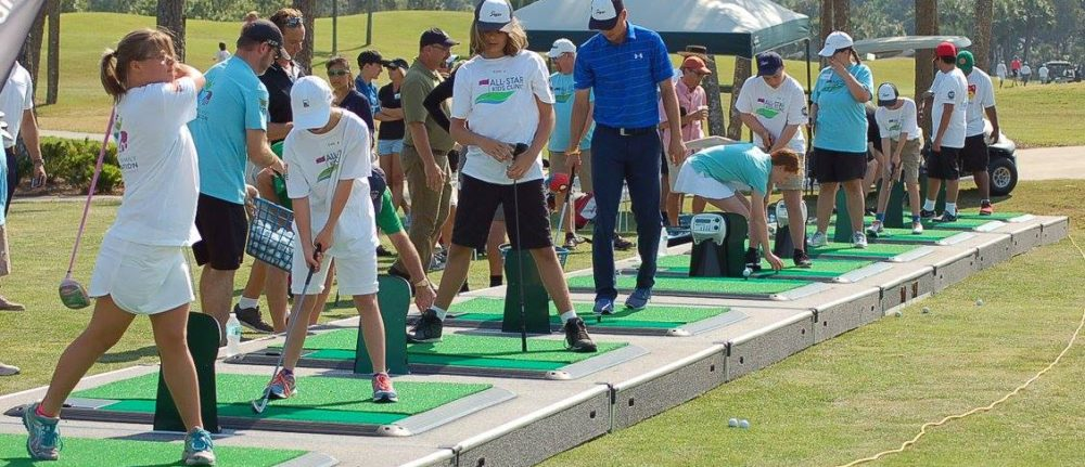 Children with special needs learn to golf at Tesori Family Foundation golf clinic